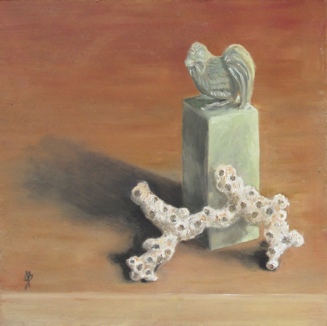 Stone Seal with Coral is a 6x6 oil painting on board by Joyce Brandon.  Still life in oils of a piece of brush coral resting against a jade green Chinese stone seal topped with a carved rooster.